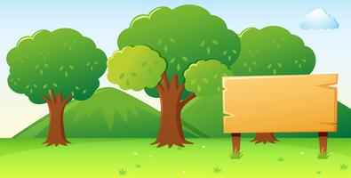 Modello di cartello in legno con sfondo foresta