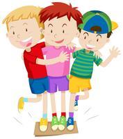 Drie jongens die een spel spelen