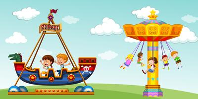 Children riding on pirate ship and swing