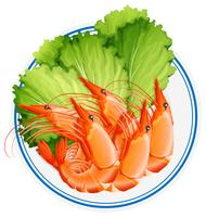 Gamberi cucinati e verdure sul piatto