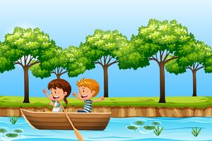 Children paddle wooden boat