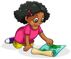 A Black young girl studying