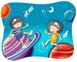 Pojke och flicka som flyter i rymden
