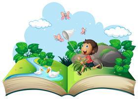 Petit garçon attrapant un papillon dans le parc