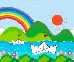 Papierboote, die in den Fluss schwimmen