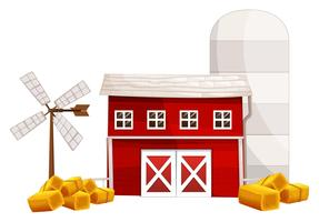 Barn and silo with hay on the ground