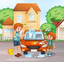 Vater und Junge waschen Auto