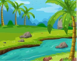 Scène avec rivière à travers le champ