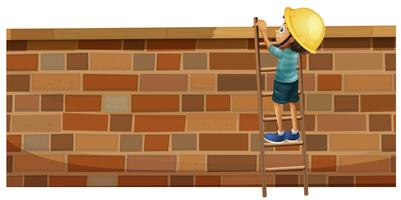 Boy climbing up the brick wall