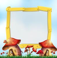 Wooden frame with mushroom houses in garden