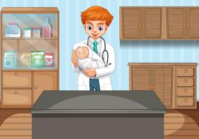 Doctor holding baby in clinic