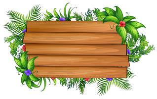 Tablero de madera con hojas verdes y flores de colores.