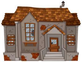 Gammalt hus med trasiga fönster och dörr