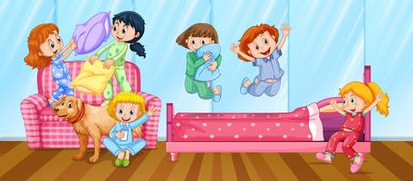 Meisjes met slaapfeestje in de slaapkamer