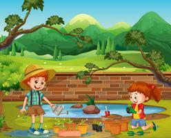 Niños plantando en el jardín
