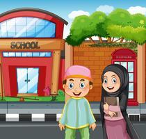 Muslimska studenter framför skolan