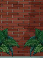 Brick wall with green leaves