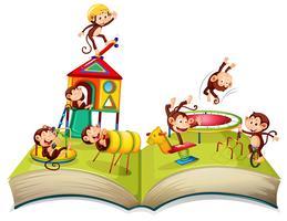 Apa på lekplatsen öppen bok