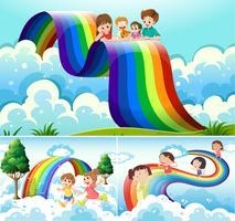 Crianças felizes sobre o arco-íris