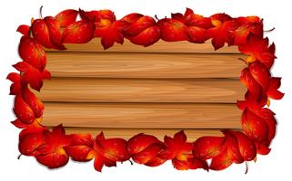 Wooden board with red leaves on border vector