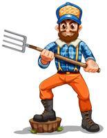 A farmer holding rake