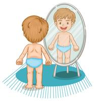 Liten pojke tittar i spegeln