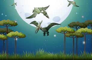 Dinosaurios volando en la noche de luna llena