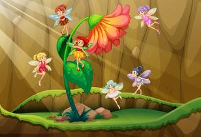 Fairies flying around the flower