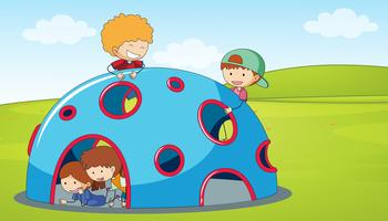 Children play climbing dome in playground