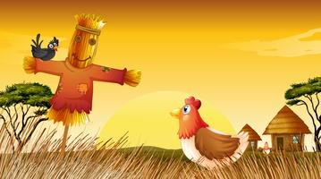 A chicken with a scarecrow and a black bird at the field
