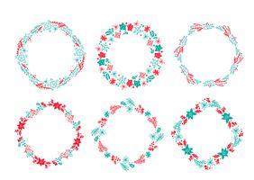 Satz Vektor Weihnachtsskandinavische Hand gezeichneter Kranz rote und blaue Blumenwinter-Gestaltungselemente lokalisiert auf weißem Hintergrund für Retro- Designblumish. Kalligraphie und Beschriftungsillustration