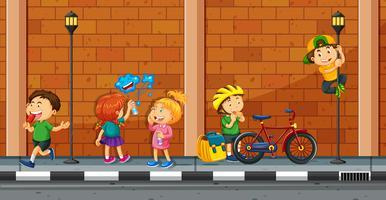 Many kids doing different activities on the street
