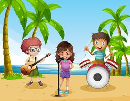 Children playing music in the band on the beach