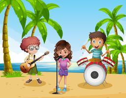 Niños tocando música en la banda en la playa.