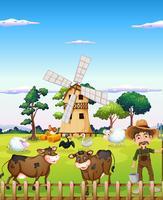 Un contadino con gli animali della fattoria