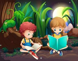 Boy and girl reading book in garden