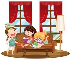Tres niñas leyendo libros en la sala