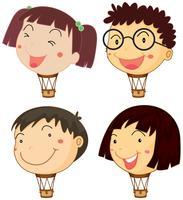 Balões com cabeças de crianças