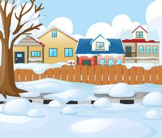 Village scene with snow on the road and houses