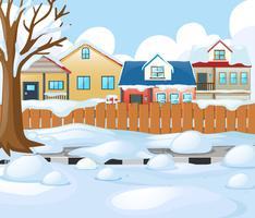 Cena de aldeia com neve na estrada e casas