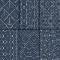 Los modelos inconsútiles geométricos blancos fijaron en fondo azul