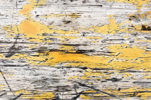 Viejo diseño texturizado de madera amarillo del fondo