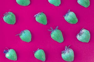 Strawberries with negative filter on pink background