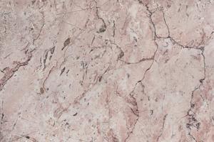 Diseño texturizado mármol rosado del fondo