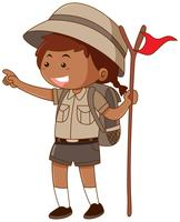 Girl in safari outfit holding flag