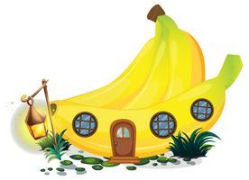 Bananhus med lyktor i trädgården
