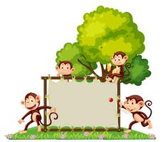 A group of monkey playing at the banner