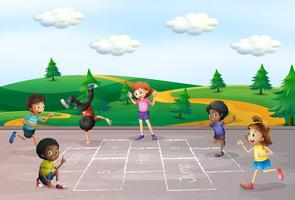 Children play hop scotch