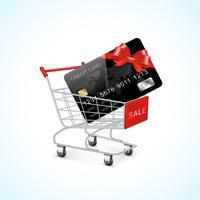 Carrito de compras con tarjeta de crédito y lazo.