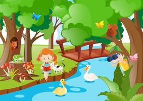 Niños y animales junto al río. vector